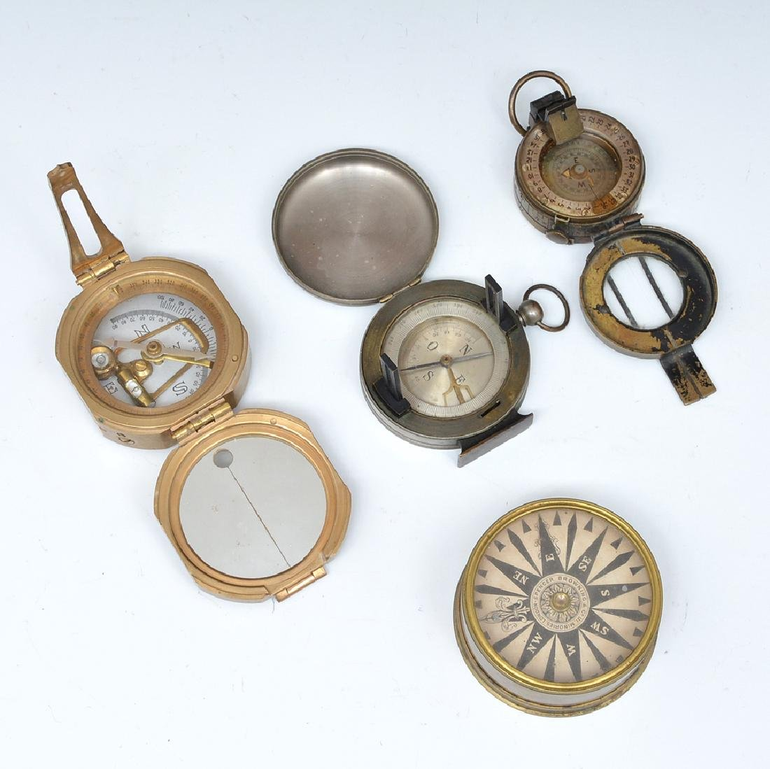 Four brass compasses, 19th/20th c