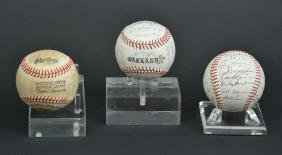 Three autographed baseballs, Oakland A's & Phillies