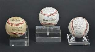 Three autographed baseballs, Oakland A's & Phillies