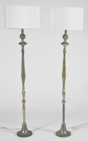 Pair of Giacometti style bronze floor lamps with shades