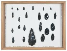 23 arrowheads mounted in diorama frame