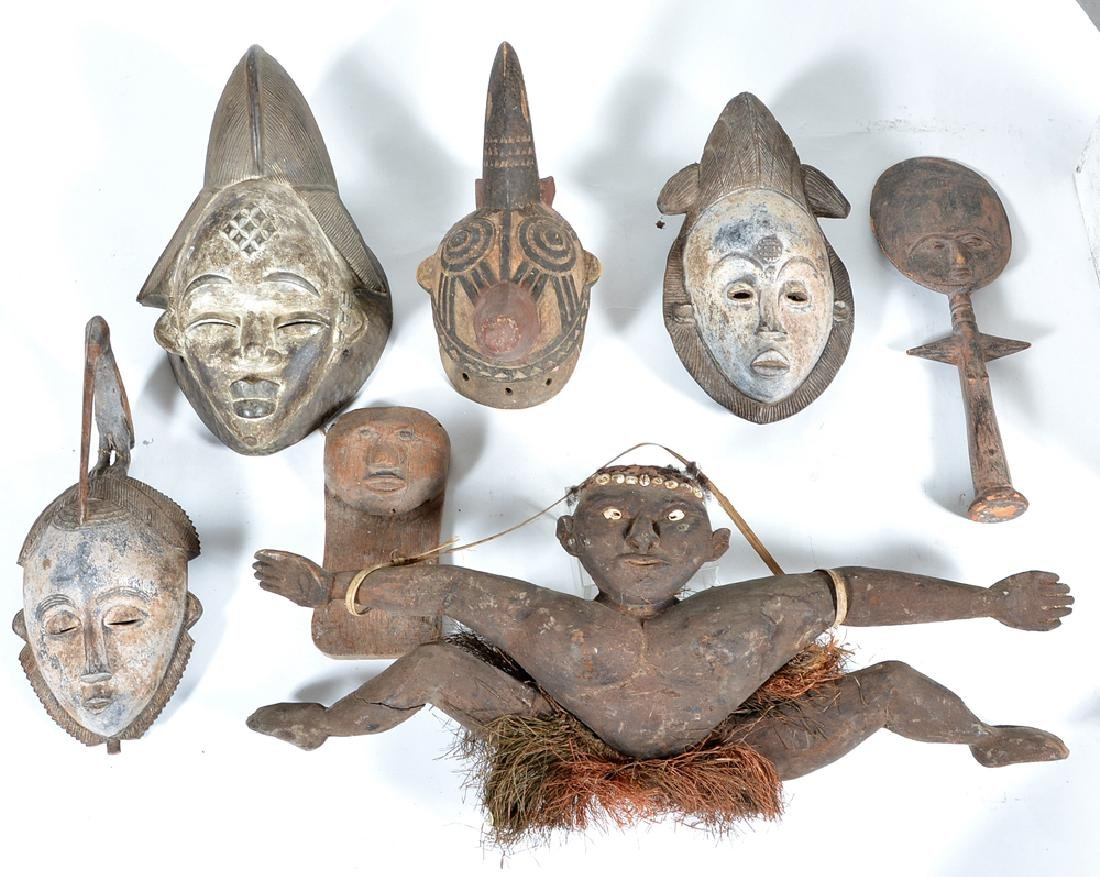6 African masks and effigy figure