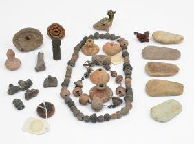 Pre-Columbian ax heads, stamps, beads, necklaces