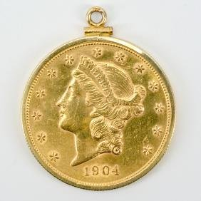 Twenty dollar gold liberty double eagle coin in bezel