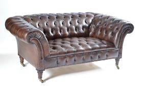 Diminutive leather Chesterfield sofa