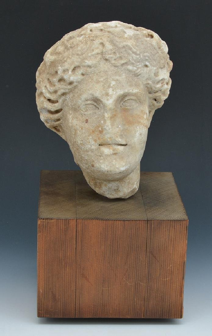 Roman marble fragment of female head on stand