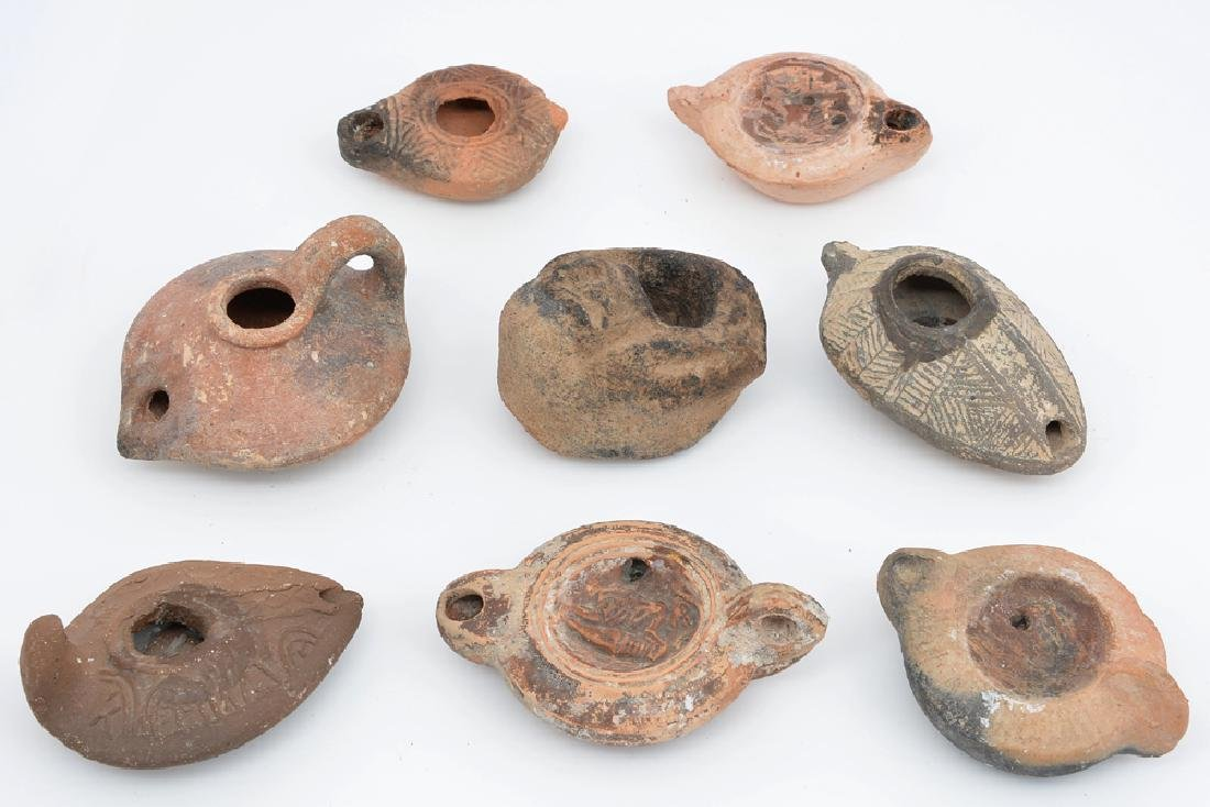 """Group of eight terracotta oil lamps, appx 4"""" long."""