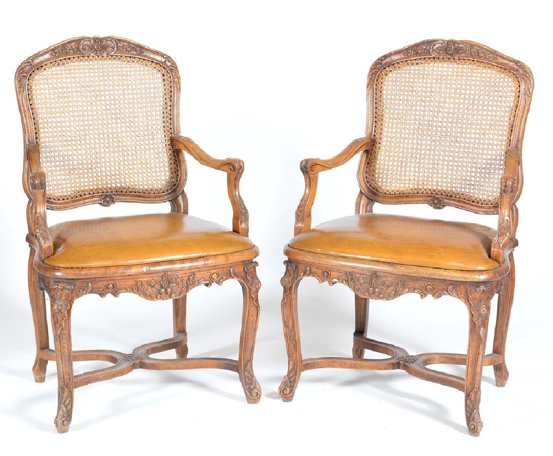 Pair of French walnut armchairs, caned backs,  18th c