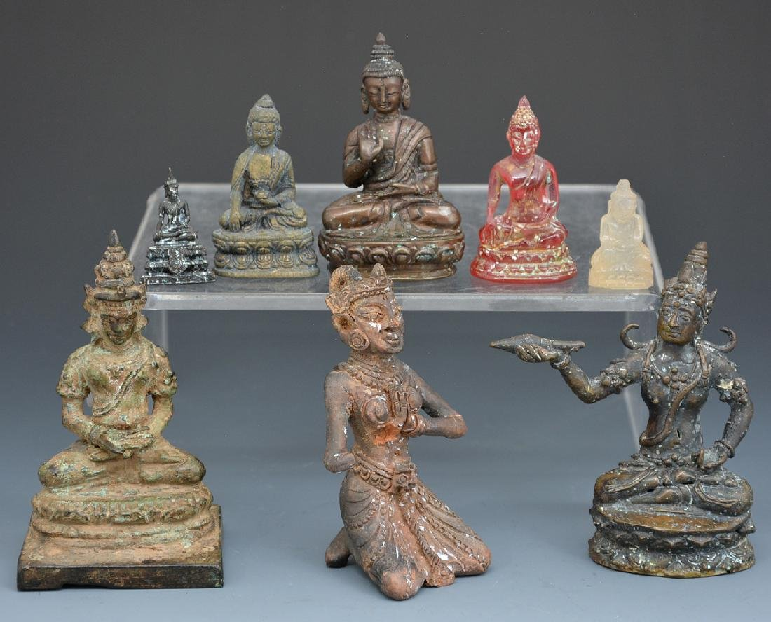Group of 8 Asian carvings, Buddhist