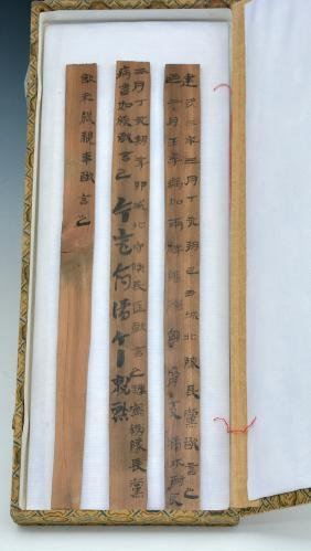 3 Chinese bamboo strips with writing, dated to 27 CE