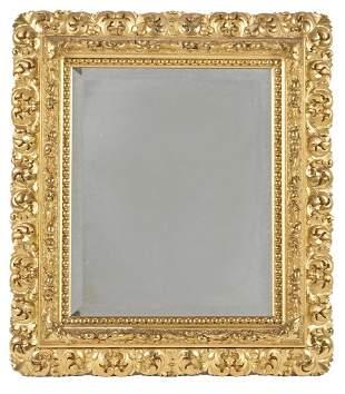 Beveled mirror in gilt frame