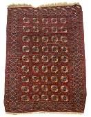 "Roomsize Persian Bokhara rug. Appx 6'11"" x 6'9"""
