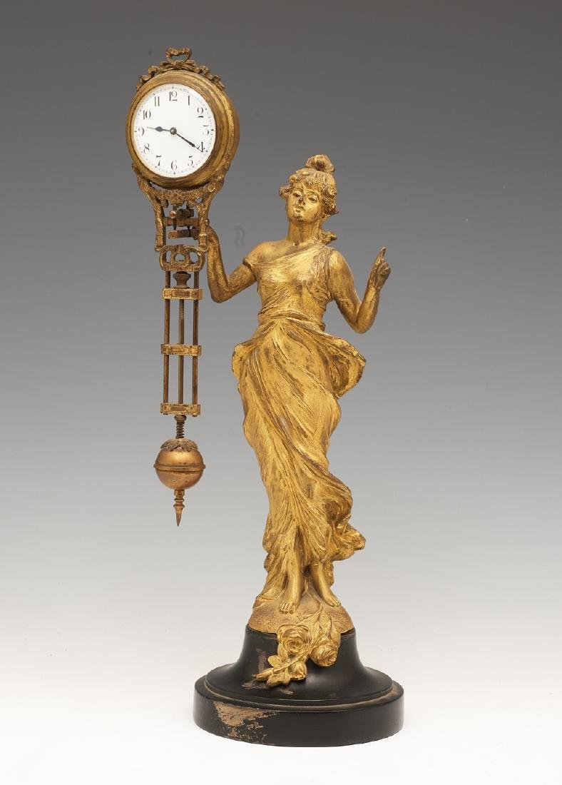 Art nouveau swinger clock, gilt bronze figure