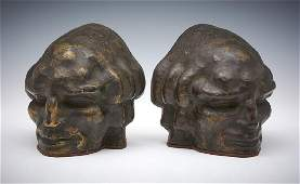 Pair of bronze bookends, face of a man, Rubinstein