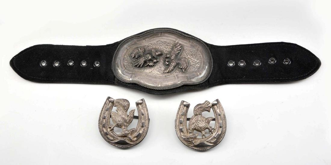 Grouping of silver belt accessories