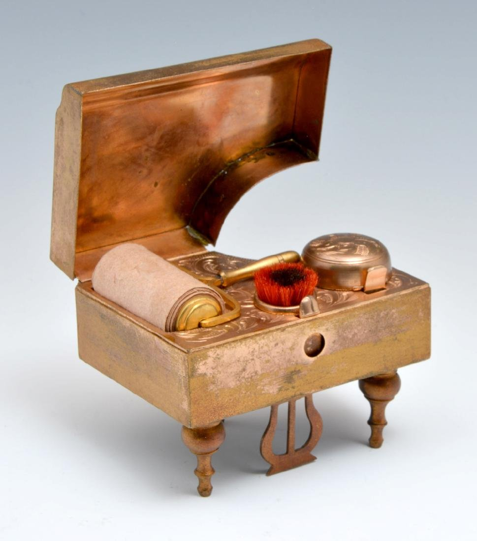 Piano shaped box with set of writing implements