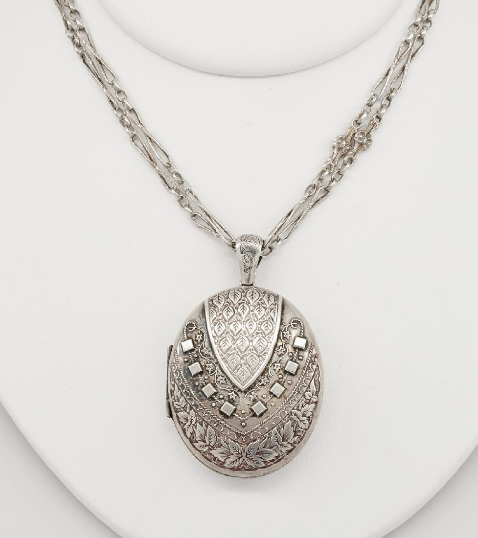 Sterling silver Victorian locket on chain with period