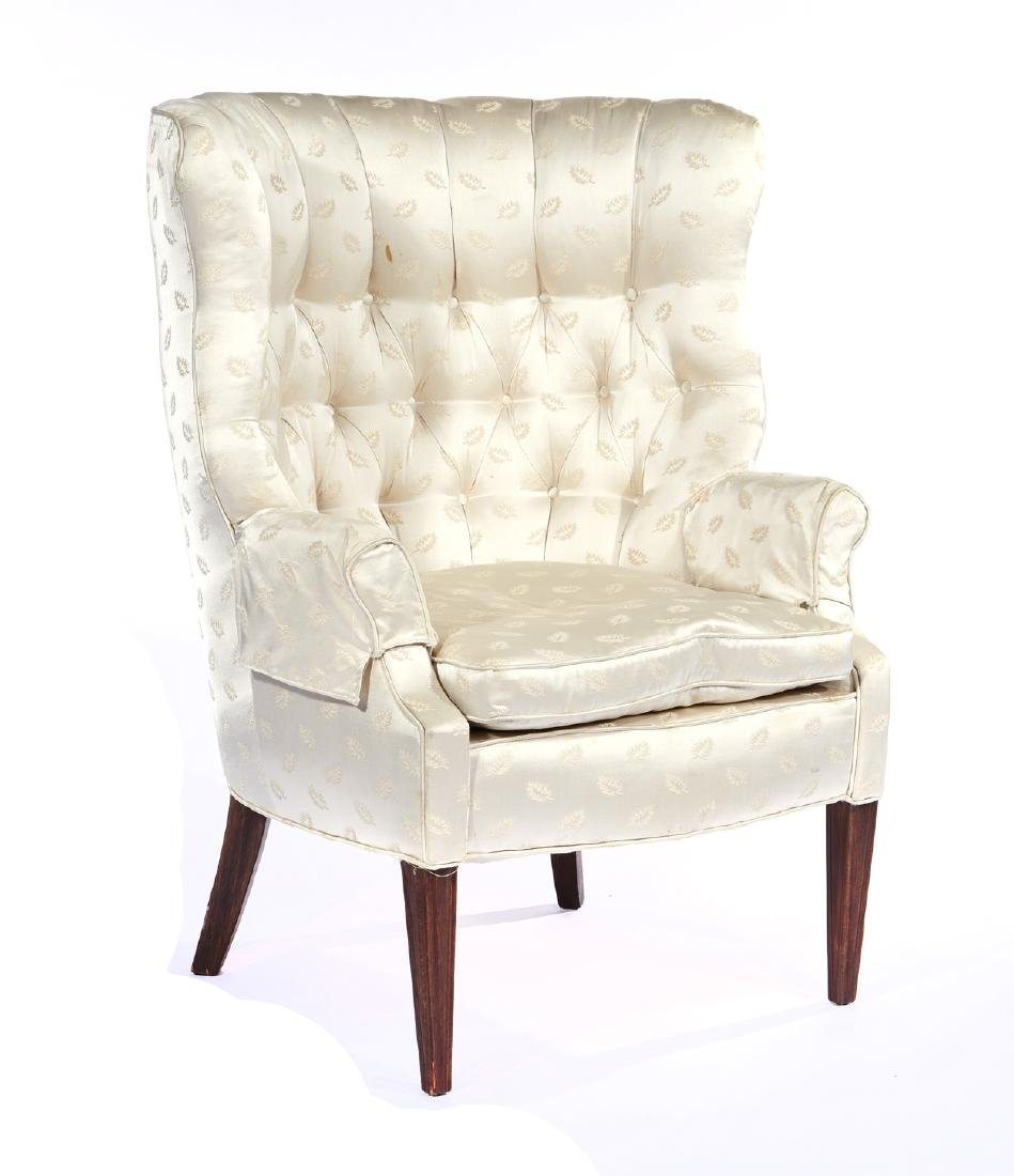 Chippendale wingback armchair with tufted upholstery