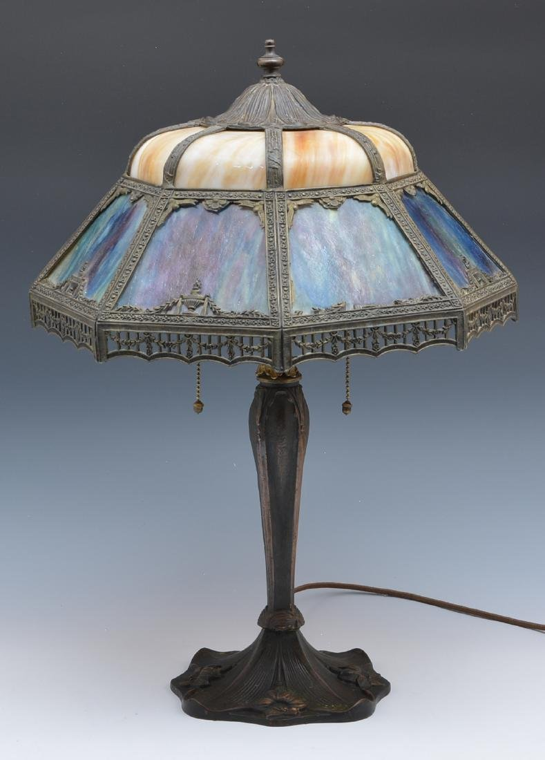 Stained glass table lamp with shaped overlay shade