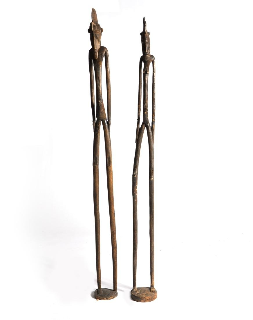 Two African Ugandan carved wooden figures