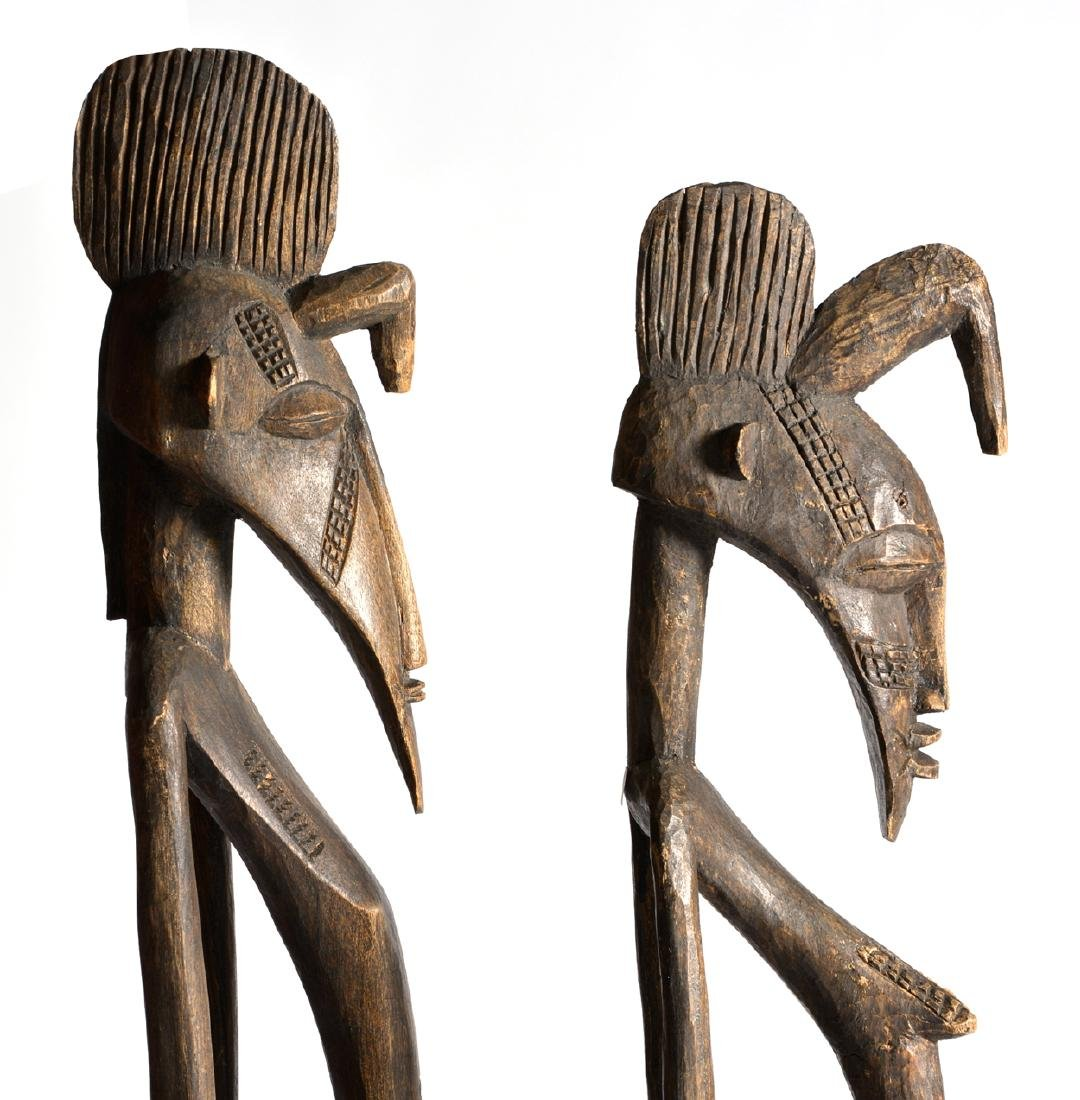 Two African Ugandan carved wooden figures - 3
