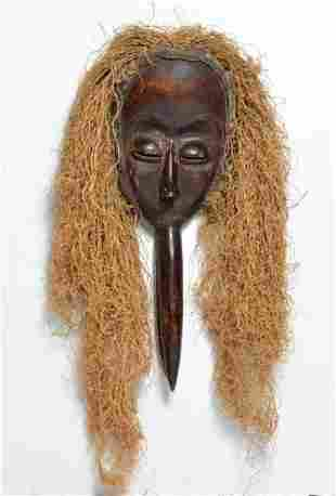 African carved wood mask with straw hair of female