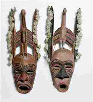 Two African Ugandan painted masks with birds