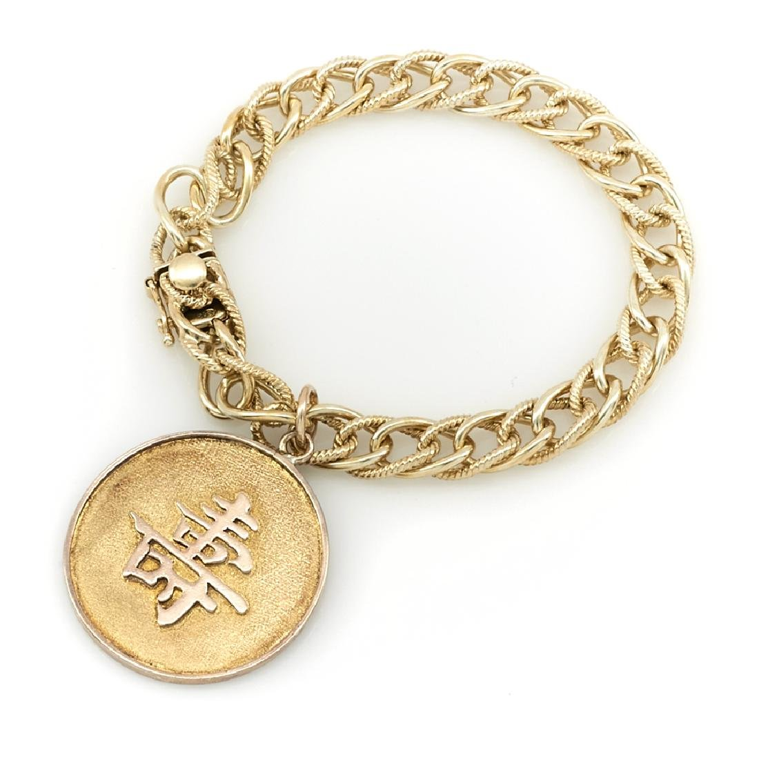 14k Yellow gold bracelet with Chinese charm