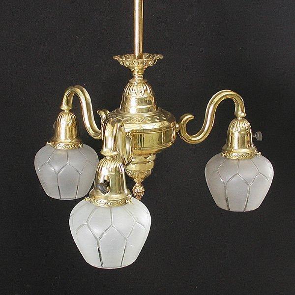 24: Three light brass chandelier, circa 1910