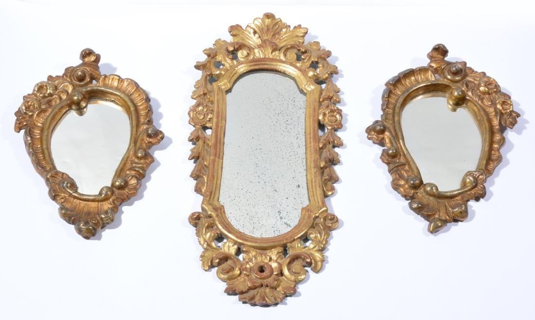 Grouping of three shaped Gilt wood mirrors
