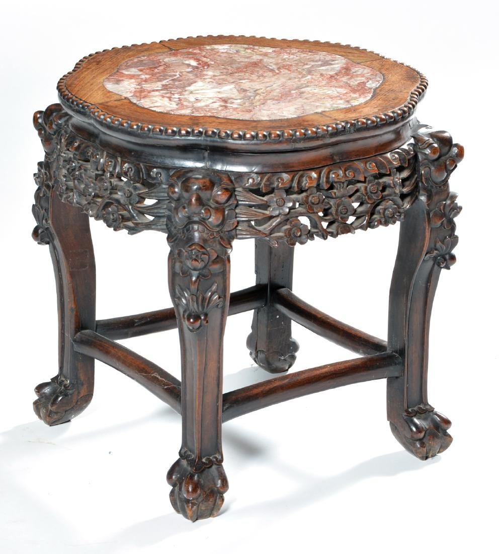 Chinese carved rosewood stand with inset marble top.