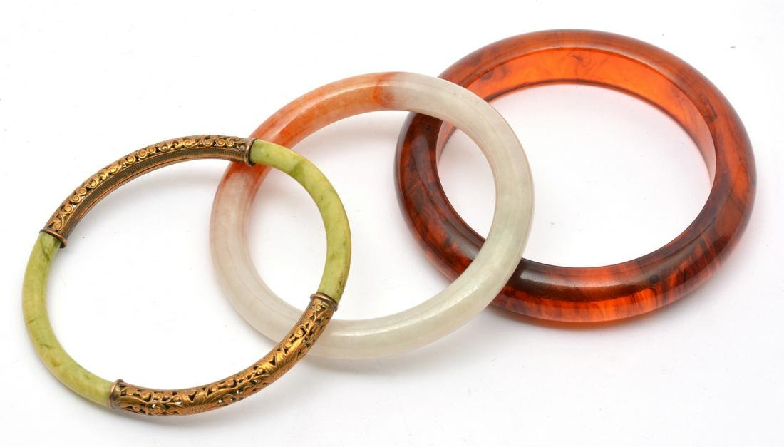 2 Chinese Jade Bangles and 1 Amber Bangle.