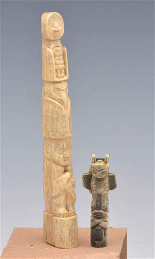 Two Eskimo Totem Poles.