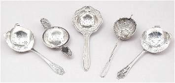 100: Five Silver Tea Strainers