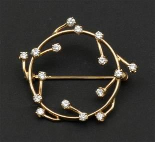 14k Yellow gold circle pin with diamonds
