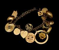 14k gold charm bracelet with fifteen charms ca. 1962