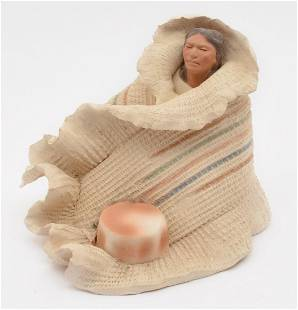 Native American porcelain woman wrapped in blanket