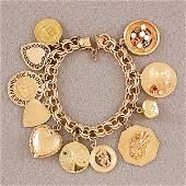 295: 14kyg Charm Bracelet w/11.