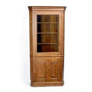 Victorian oak corner cabinet with bevel glass door