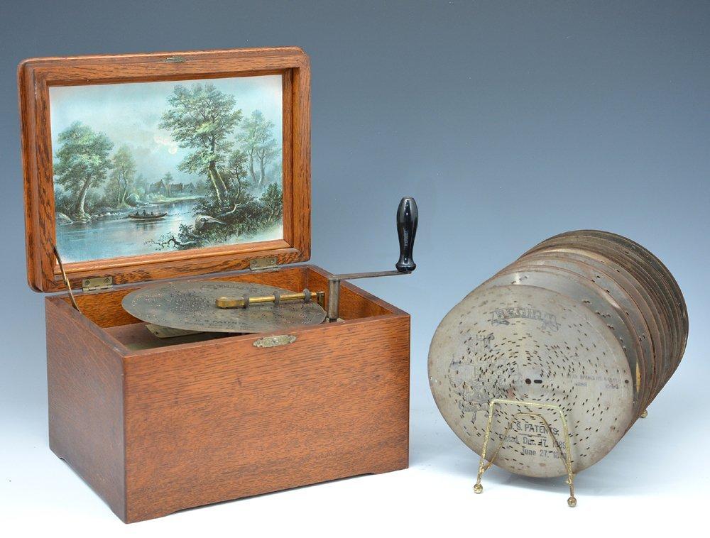"Regina music box with oak case, 19 - 8"" discs"