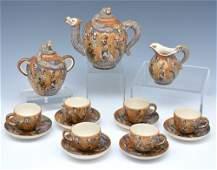 """Satsuma dragonware tea set, 15 pcs. Teapot: 6 1/2""""t."""