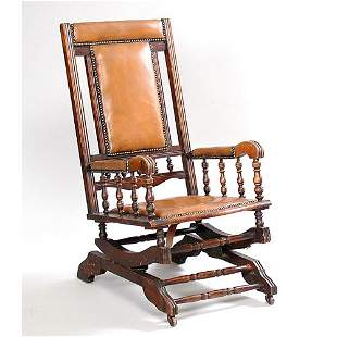 Platform Rocker with Leather Upholstery.