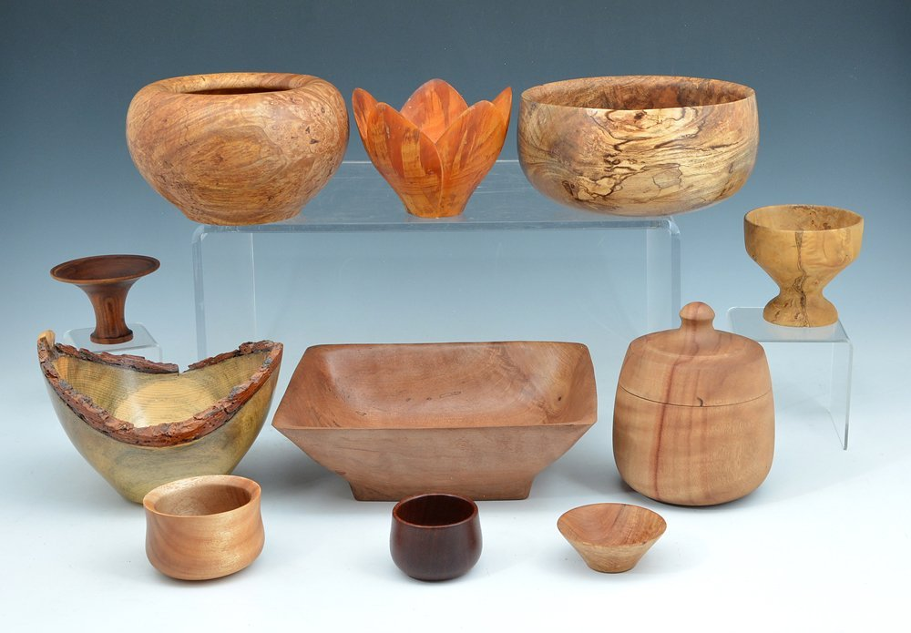 11 Bowls of carved western woods, various artists