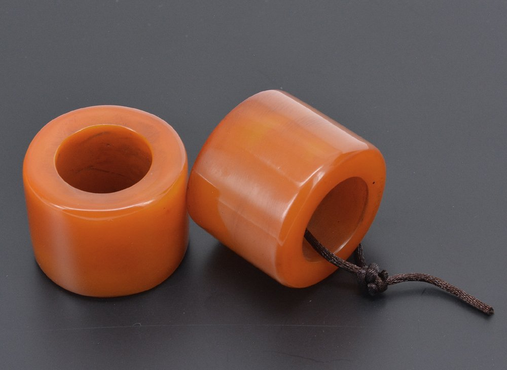 Two Carved Honey Amber Rings