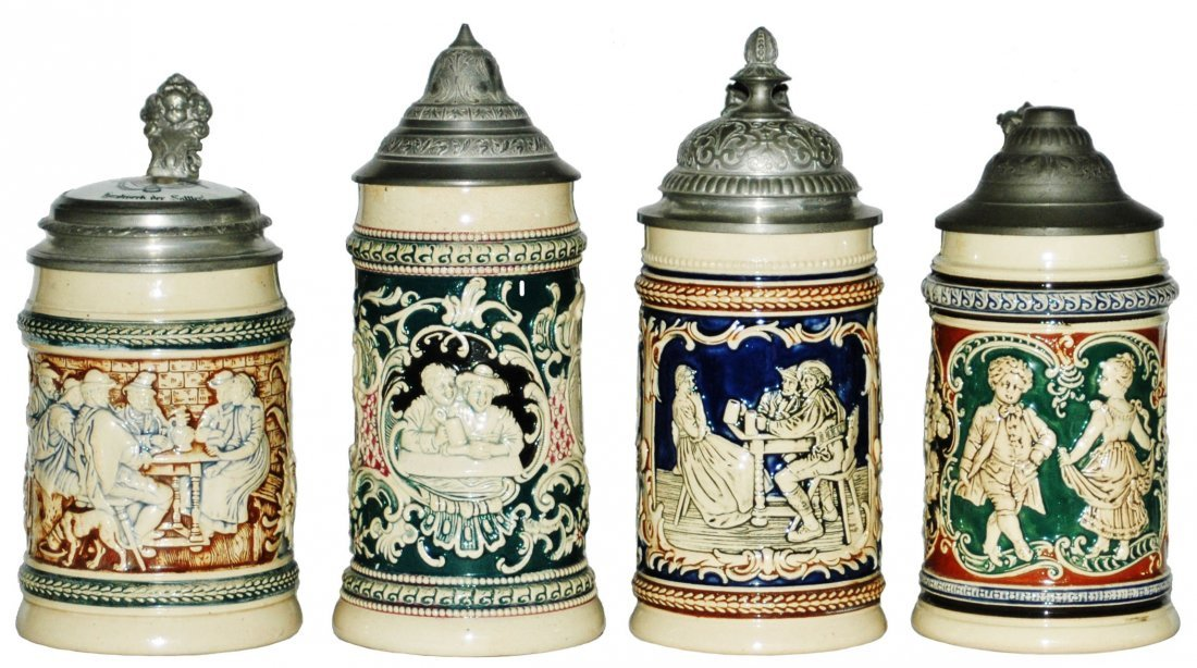 Lot of 4 Pottery Relief Steins - All Mint