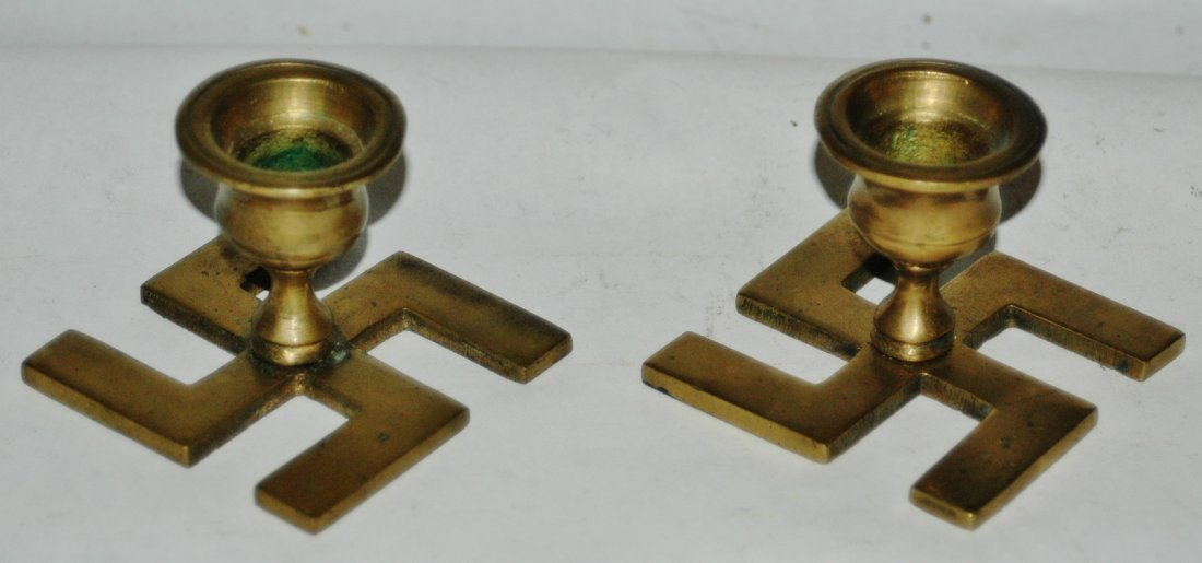 Pair of Third Reich swastika Nazi brass candle sticks