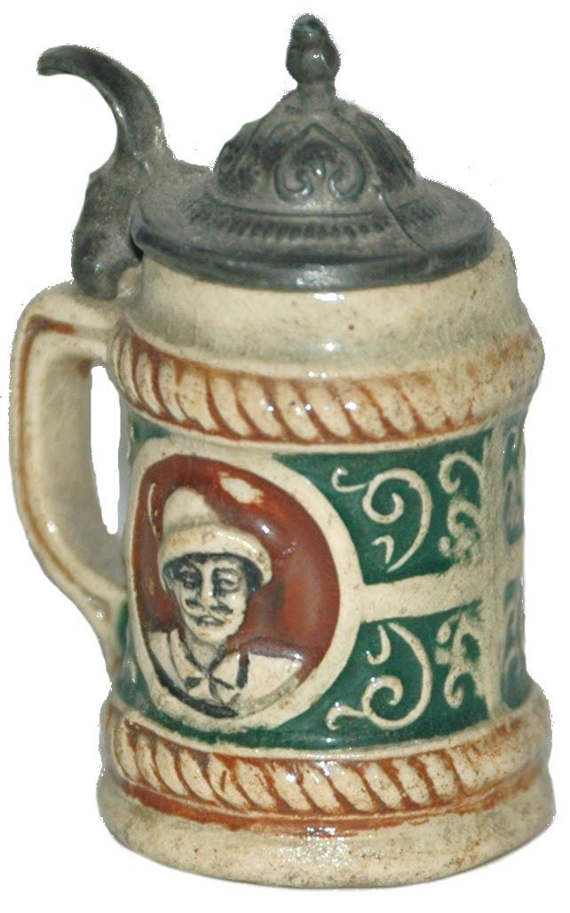 18: Miniature Pottery Stein with Faces