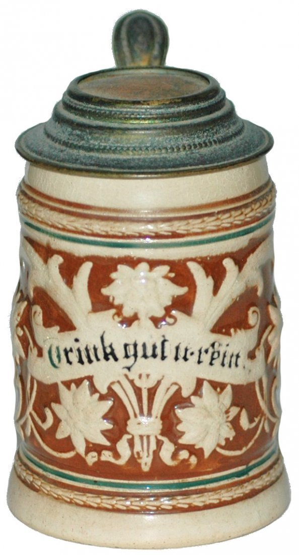 10: Floral 1/8 L. Pottery Relief Stein