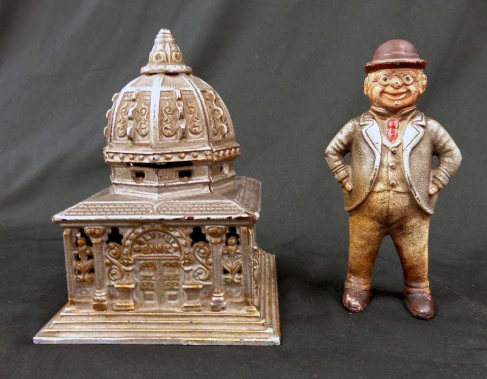 2 Cast Iron Antique Banks Columbia Bank and Standing Ma