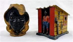 2 Cast Iron Antique Banks SLAVE BOY and SLAVE SHACK